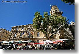 aix en provence, blues, buildings, city hall, clock tower, colors, europe, france, horizontal, market, provence, structures, towers, trees, umbrellas, photograph