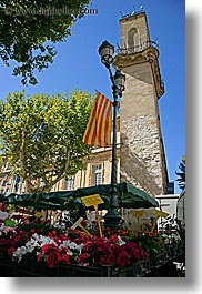 aix en provence, clock tower, colorful, colors, europe, flags, flowers, france, nature, provence, vertical, photograph