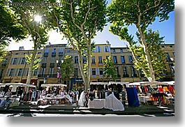 aix en provence, buildings, colors, europe, france, green, horizontal, market, nature, provence, sky, structures, sun, tents, trees, photograph