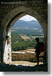 arches, archways, bargeme, doors, europe, france, gothic, hikers, materials, men, people, provence, scenics, silhouettes, stones, structures, vertical, photograph