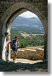 arches, archways, bargeme, doors, europe, france, gothic, hikers, men, people, provence, scenics, structures, vertical, photograph