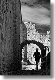 archways, bargeme, black and white, buildings, castles, europe, france, hikers, hiking, materials, men, people, provence, silhouettes, stones, structures, vertical, photograph