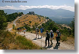 bargeme, buildings, castles, europe, france, groups, hikers, hiking, horizontal, people, provence, structures, photograph
