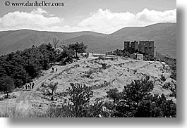 bargeme, black and white, buildings, castles, europe, france, hikers, hiking, horizontal, materials, people, provence, stones, structures, photograph