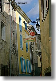 buildings, castellane, colorful, europe, france, pizzeria, provence, signs, towns, vertical, photograph