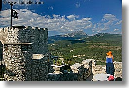 blues, castles, chateau trigance, clothes, colors, europe, flags, france, green, hats, horizontal, materials, nature, oranges, provence, scenics, stones, photograph
