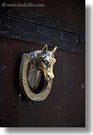 browns, colors, doors, europe, fayence, france, heads, horses, knockers, provence, vertical, photograph