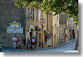 branches, europe, fayence, france, groups, horizontal, nature, pedestrians, people, plants, provence, shady, streets, trees, photograph