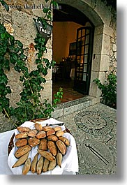bread, doors, europe, foods, france, materials, provence, stones, vertical, photograph