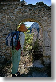 activities, architectural ruins, archways, europe, france, hikers, hiking, looking, people, provence, structures, vertical, photograph
