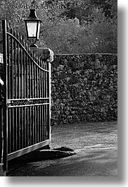 black and white, europe, france, gates, hotel des messugues, irons, lamps, materials, provence, vertical, photograph
