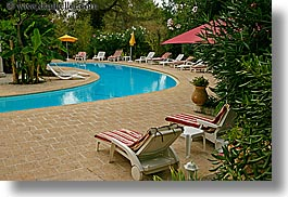 chairs, colors, europe, france, green, horizontal, hotel des messugues, nature, pools, provence, recliner, water, photograph