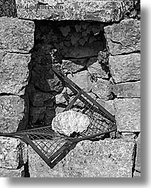 abstracts, arts, black and white, europe, france, grates, provence, rocks, stones, vertical, photograph