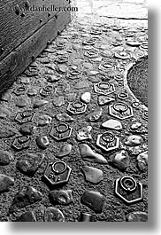 black and white, cobblestones, europe, floors, france, irons, materials, moulin de camandoule, provence, stones, vertical, weights, photograph