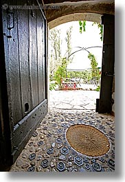 archways, cobblestones, doors, europe, floors, france, materials, moulin de camandoule, provence, stones, structures, vertical, weights, photograph