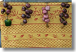 colors, europe, foods, france, horizontal, moustiers, onions, provence, st marie, table cloth, yellow, photograph
