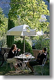 breakfast, clothes, colors, couples, europe, france, green, hotels, moustiers, provence, st marie, vertical, photograph