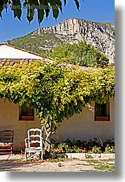 chairs, colors, europe, france, green, houses, mountains, moustiers, provence, st marie, vertical, photograph