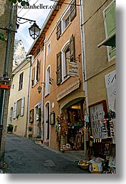 buildings, europe, france, gifts, moustiers, narrow, narrow streets, provence, st marie, stores, streets, structures, vertical, photograph