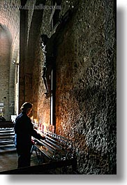 buildings, candles, churches, crosses, europe, france, materials, monestaries, moustiers, notre dame de beauvoir, people, provence, religious, st marie, stones, structures, vertical, womens, photograph