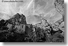 black and white, buildings, cliffs, clouds, europe, france, horizontal, monestaries, mountains, moustiers, nature, notre dame de beauvoir, provence, religious, sky, st marie, structures, photograph