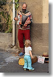 accordion, bald, beards, childrens, colors, europe, france, girls, men, moustiers, people, players, provence, red, st marie, toddlers, vertical, photograph