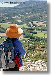 backpack, clothes, colors, europe, france, hats, landscapes, moustiers, oranges, provence, scenics, st marie, vertical, viewing, womens, photograph