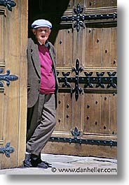 doors, europe, france, gothic, men, old, people, provence, vertical, photograph