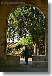 arches, europe, france, people, provence, scenics, trees, vertical, womanin, womens, photograph