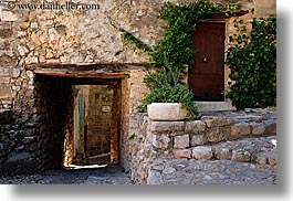 doors, europe, france, horizontal, ivy, materials, nature, plants, provence, seillans, stones, tunnel, photograph