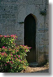 arches, archways, colors, doors, europe, flowers, france, green, materials, nature, provence, seillans, stones, structures, vertical, photograph