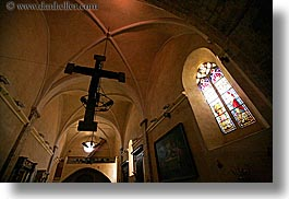 buildings, churches, crosses, europe, france, glasses, hangings, horizontal, materials, provence, religious, seillans, stained, stained glass, structures, windows, photograph