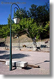 colors, europe, france, green, lamp posts, nature, plants, provence, seillans, trees, vertical, photograph