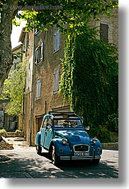 blues, buildings, cars, colors, covered, europe, france, green, ivy, nature, old, plants, provence, seillans, vertical, photograph