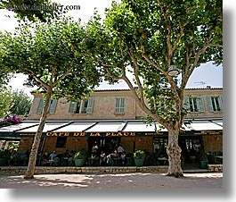 cafes, europe, france, horizontal, nature, plants, provence, st paul, trees, umbrellas, photograph