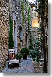 chairs, cobblestones, europe, france, materials, narrow, provence, st paul, stones, streets, vertical, photograph