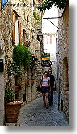 couiple, couples, europe, france, men, narrow, people, provence, st paul, streets, vertical, walking, womens, photograph