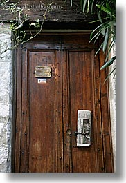 browns, colors, doors, europe, france, newspaper, provence, st paul, vertical, photograph