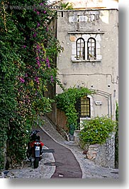 bougainvilleas, cobblestones, europe, flowers, france, houses, ivy, materials, motorcycles, nature, paths, plants, provence, st paul, stones, vertical, photograph