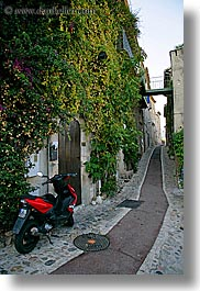 bougainvilleas, cobblestones, colors, europe, flowers, france, green, ivy, materials, motorcycles, narrow, nature, plants, provence, red, st paul, streets, vertical, photograph