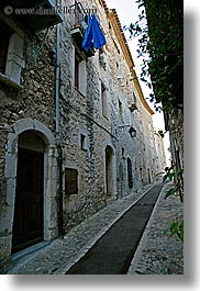 archways, blues, cobblestones, europe, france, materials, narrow, provence, st paul, stones, streets, structures, towels, vertical, photograph