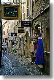 cobblestones, europe, france, materials, narrow, provence, st paul, stones, storefronts, streets, vertical, photograph