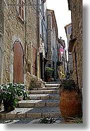 archways, europe, france, materials, narrow, plants, provence, st paul, stairs, stones, streets, structures, vertical, photograph