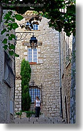 europe, france, ivy, materials, nature, people, plants, provence, st paul, stairs, stones, structures, vertical, womens, photograph