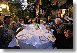 dinner, dusk, europe, foods, france, groups, horizontal, outdoors, people, provence, tables, wine glass, womens, photograph