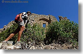 activities, architectural ruins, backpack, buildings, clothes, europe, france, groups, hiking, horizontal, men, nicos, people, provence, structures, sunglasses, photograph