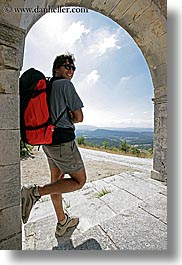 arches, archways, backpack, clothes, clouds, colors, europe, france, groups, men, nature, nicos, people, provence, red, sky, structures, sunglasses, vertical, photograph