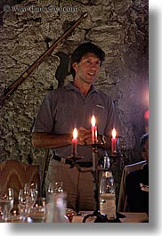 candles, clothes, dinner, europe, foods, france, groups, men, nicos, people, provence, sunglasses, vertical, photograph
