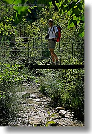 activities, backpack, bridge, clothes, colors, europe, forests, france, green, groups, hiking, men, nature, nicos, people, plants, provence, red, structures, swing bridge, swings, trees, vertical, photograph
