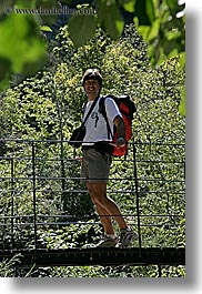 activities, backpack, bridge, clothes, colors, emotions, europe, forests, france, green, groups, happy, hiking, men, nature, nicos, people, plants, provence, red, structures, swing bridge, swings, trees, vertical, photograph